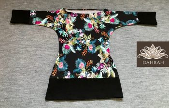 Beautiful Dahrah woman T-shirt, organic stretch cotton with flower pattern on black background.