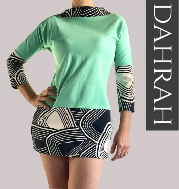 Beautiful Dahrah green women T-shirt, with white and navy blue abstract pattern.