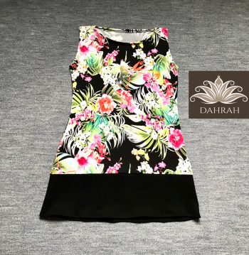 Dahrah, lady top of stretch cotton, with a beautiful colorful flower pattern on black background.
