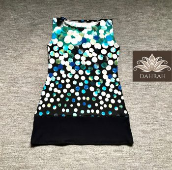 Dahrah, lady top made with stretch cotton, with a beautiful blue, green and white dot pattern on navy blue background.