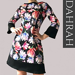 Beautiful Dahrah fashion lady dress, colorful flower pattern on black background.