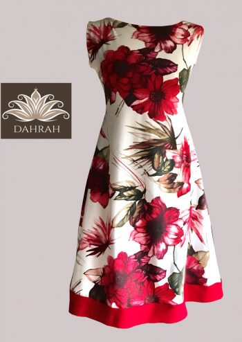 Beautiful Dahrah woman dress in organic cotton, with white and red flower pattern.
