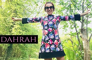 Beautiful Dahrah fashion women dress, colorful flower pattern on black background.