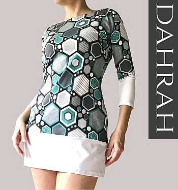 Beautiful woman long T-shirt by Dahrah, with geometrical pattern in blue green tones on white background.
