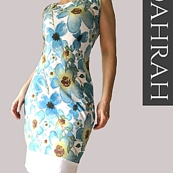 Dahrah, beautiful summer dress with light blue flower pattern on white background.