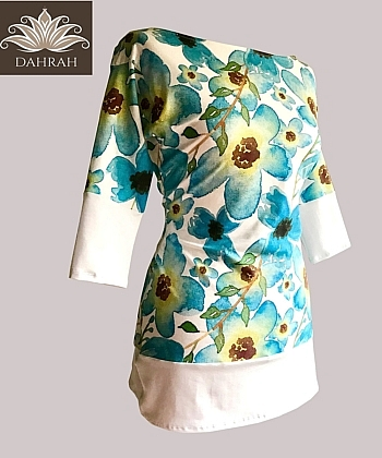 Dahrah, beautiful and colorful summer T-shirt for woman with flower turquoise pattern on white background.