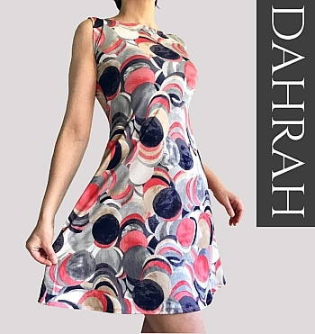 Beautiful Dahrah woman dress in fresh and light viscose, dot abstract pattern in coral, grey and blue shades.