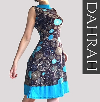 Beautiful woman summer dress by Dahrah, with abstract pattern in turquoise shades on a brown background.
