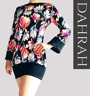 Beautiful Dahrah woman T-shirt, with beautiful magnolia flowers in pink tints on black background.