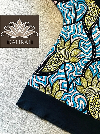 Beautiful Dahrah T-shirt made with amazing African print fabric with psychedelic and ethinc pattern in blue and yellow shades.