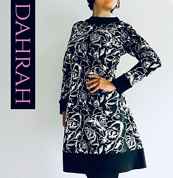 Beautiful and elegant winter dress by Dahrah Fashion with white flower pattern on black background.