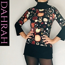 Dahrah Fashion cotton mix T-shirt for women, with abstract big dot pattern in warm colors like red, orange and brown, on black baground.