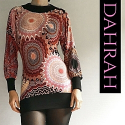 Dahrah Fashion cotton mix T-shirt for women, with abstract geometrical pattern in warm colors like red, orange and black.