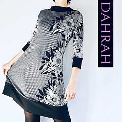 Beautiful and elegant winter dress by Dahrah Fashion with flower pattern at one side on checkered taupe-black background.