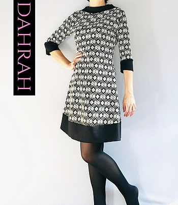 Beautiful and elegant winter dress for women by Dahrah Fashion with geometric black and white pattern.