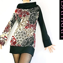 Beautiful Dahrah Fashion sweater with a playful asymmetrical design, one side black and one side with beautiful abstract flower fantasy.