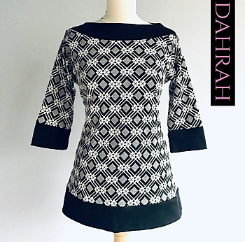 Dahrah Fashion viscose sweater for women with black, grey and white checkered background.