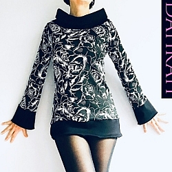 Dahrah Fashion winter sweater for women with white flower pattern on black background.