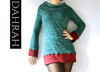Beautiful green winter sweater by Dahrah with boredaux edges and wide turte neck.