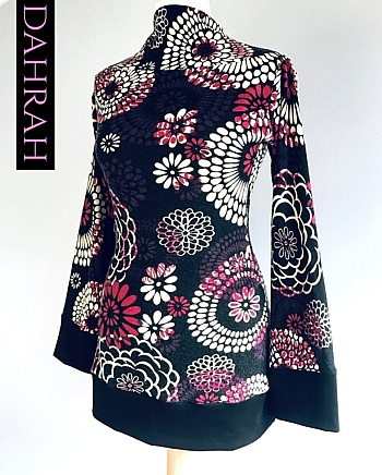 Dahrah Fashion winter sweater with abstract floral ethnic pattern in deep red and white tones on dark background.
