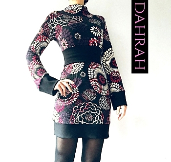 Winter dress by Dahrah Fashion with ethnic pattern in deep red and white shades on black background.