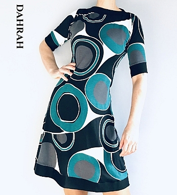 Beautiful Dahrah fashion women dress, realized in cotton and viscose jersey with asbtarct green-black pattern with irregular big circles.
