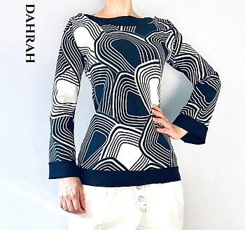 Beautiful Dahrah woman blouse for the spring collection with beautiful navy blue abstract patter on white background.