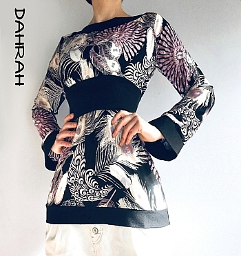 Beautiful Dahrah woman summer blouse in viscose fabric with peakock feathers patterns on black baclground.