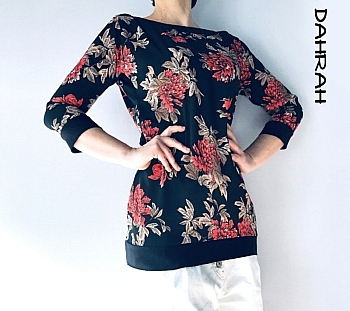 Beautiful Dahrah woman summer blouse with deep orange-red flowers on black background.